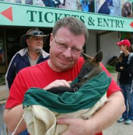 Holding a baby wallaby