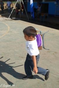 Carrying his chair to his new classroom