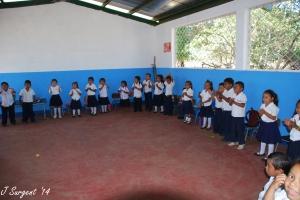 Preschool students singing and dancing